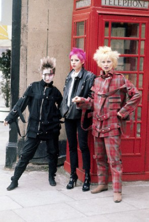 ca. April 12, 1977, London, England, UK --- Vivienne Westwood (in plaid) leans against a telephone box with other punk girls on a London street. --- Image by © Condé Nast Archive/Corbis